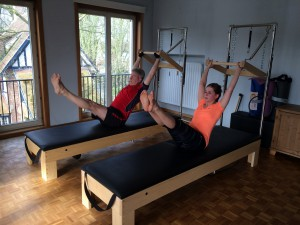 Pilates oefening op Tower: the Teaser