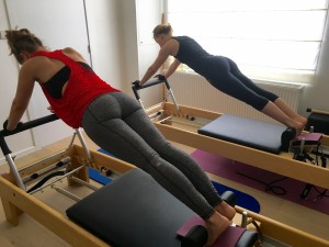 Pilates op Reformer: the plank